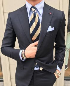 A striped tie in gold and navy always looks classy.