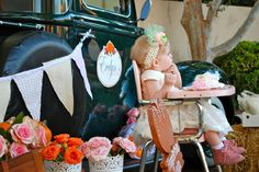 roses and pumpkin pink and orange first birthday party farm pickup truck provides photo opportunity backdrop