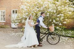 Bride & groom fun riding vintage bicycle at Iscoyd Park by Gemma Williams Photography