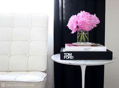 Small shop vignette: peonies & Saarinen tulip side table