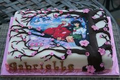 Inuyasha Japanese Anime Cake - Chocolate cake with cherry filling. Covered in bc & Duff fondant. Fudge icing for piping of tree.  Fondant cherry blossoms. Edible image.