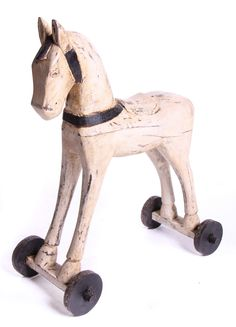 Spectacular handcrafted wood horse on wheels.