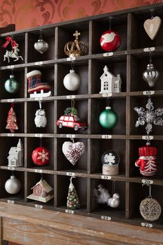 This wood cubby from @HomeGoods made the perfect DIY ornament calendar! Just add hooks, and your favorite old and new ornaments for a #HomeGoodsHappy holiday display!  Click through to our blog for more decor inspiration