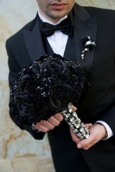 Grace Ormonde Wedding Style Platinum Member Nisie's Enchanted Florist Los Alamitos, CA. Black chiffon rosettes, sequins flowers and silk roses with crystal accents. Photography: Mike Colón Photographers Newport Coast, CA. http://www.weddingstylemagazine.com/photo-galleries/bouquets