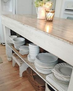 This farmhouse style kitchen shows off a charming collection of tableware.