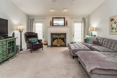 The family room has vaulted ceilings, a gas burning fireplace, and patio access. North Palm Beach, Palm Beach County, Patio Design, House Design, Room Dimensions, Updated Kitchen, Gas Fireplace, Granite Countertops, Great Rooms