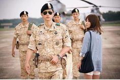 Song Hye Kyo and Song Joong Ki exuding perfect chemistry. The scene portrays the fateful meeting of Song Joong Ki and Song Hye Kyo. of the sun Song Joong Ki Drama, Hau Due Mat Troi, Descendants Of The Sun Wallpaper, Song Hye Kyo Descendants Of The Sun, Kdrama, Soon Joong Ki, Decendants Of The Sun, Sun Song, Moorim School