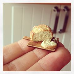 mini fresh baked bread on a tiny cutting board