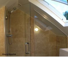 It can be a tricky process to install a shower in an attic bathroom because of the sloping angles and limited ceiling height. But with a bespoke shower screen it's possible to have a shower under the eaves. This shower screen was shaped to fit and has a hinged door. For more examples please take a look at our website