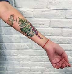 No nature tattoos are quite as stunning as those created by Ukrainian tattoo artist Rita Zolotukhina (AKA Rit Kit on Instagram). Rita uses real leaves and flowers to design true-to-life tattoos. She dips her found leaf or flower in stencil ink, places it on her client's skin, then traces the impression with her tattoo gun.