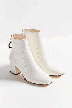 Shop Harlow Faux Leather O-Ring Ankle Boot at Urban Outfitters today. We carry all the latest styles, colors and brands for you to choose from right here. White Leather Ankle Boots, White Boots, Lace Up Boots, Leather Sandals, Sock Shoes, Cute Shoes, Heeled Boots, Bootie Boots, Fashion Shoes