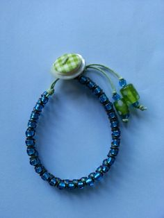 FOR SALE!! Handmade seed bead and jump ring braided bracelet with gingham printed button on shell button fastener. Lime green and blue. Perfect for summer and comfortable to wear £8.00 + £2.50 P Message me on Facebook: Dragonfly Sun if you would like to know more! :-)