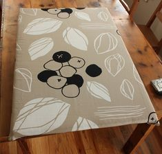 DIY ironing board. Best of all, you can pick the fabric. Could also be done with an old TV tray.