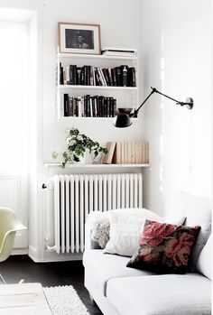 I love the black and white first. But I love the way the bookshelf is effortless, simple, and utilizes a space that does not see a human element in the typical house. The protruding desk-lamp looking light is wonderful for a reader.