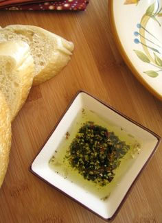 Italian Herb Dipping Sauce...Eating out is one of the first things to go when tightening the food bill....sometimes I miss the special little touches of a meal at a restaurant, especially when they bring you a hot loaf of bread and some flavored olive oil to dip it in....This is a super simple way to enjoy all those great flavors at home.