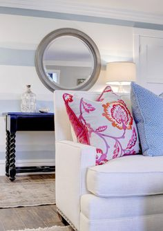 The Sitting Room Studio. Got to love a white sofa with fun colors. We used dark accent pieces to balance the space.