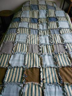 My latest raggy quilt made from recycled material i had stashed away. The plan was to make a warm curtain for our garage, but we liked it so much it is now a warm snuggly quilt. Because of the thickness of the material in the seams I used my faithful  100 yr old singer to do the quilting, it makes light work of it.
