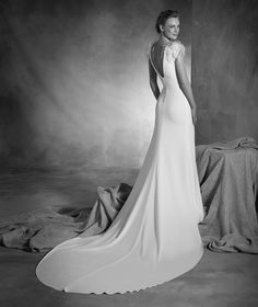 Naomi - Wedding dress with a bateau neckline, gemstones and feathers