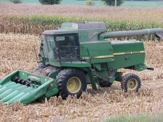 John Deere 7720 Titan ll off of Route 38.Combine must be close to  30 years old.