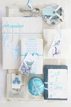 Less traditional ways to wrap gifts – from tea tins to a stack of books tied together with ribbon and topped with a handmade greeting.
