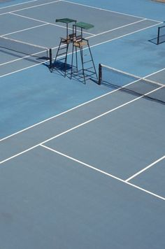 perfect shades of blue and sharp lines - blue tennis court from above.