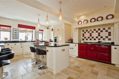 red aga country kitchen