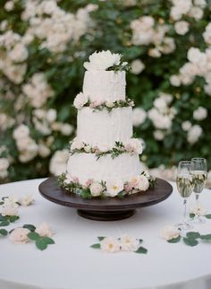 Garden-style wedding cake - buttercream-frosted wedding cake with greenery and florals {Greg Finck}
