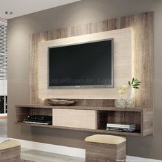 Simple, modern TV unit, with texture/material accent wall backing.