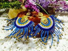 Gorgeous micro macrame earrings with Brass Beads in Multi-Colored wax threads . The earrings are very light and comfortable to wear,  -like how she cast on to the last metal circle