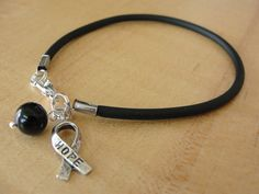 Black Awareness Bracelet - Hope Ribbon - Melanoma, Narcolepsy, Trauma. $5.00, via Etsy.