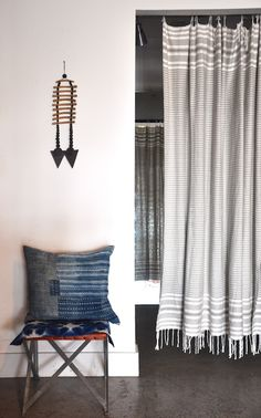 I love the look of curtain. It's an inexpensive substitution for a door if you want something lighter and more fashionable.