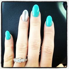 mint green almond shaped nails