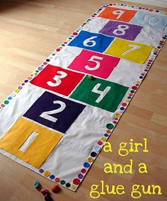 What do you do when the weather is bad outside? Bring the outside game inside! A simple way to make a hopscotch game. Then flip it over and add a couple more games to the back.