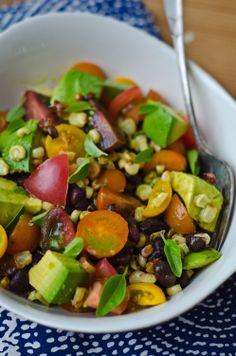 Corn, avocado, black bean and tomato salad with basil vinaigrette http://www.scalingbackblog.com/savory-bites/27384598505/
