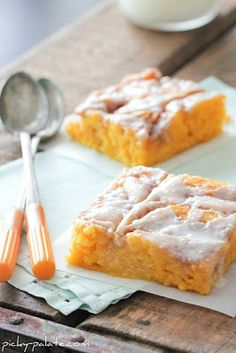 """Cinnamon Roll Pumpkin Vanilla Sheet Cake (13x18"""" pan)     1 box yellow cake mix     4 eggs     1/2 cup canola or vegetable oil     1/2 cup milk or buttermilk     3.4 ounce box Vanilla Instant Pudding Mix     1/2 cup sour cream     15 ounce can pumpkin     1 stick (8 tablespoons) unsalted butter     3/4 cup packed light brown sugar     1/2 teaspoon ground cinnamon     3/4 cups powdered sugar     1/4-1/2 cup heavy cream"""
