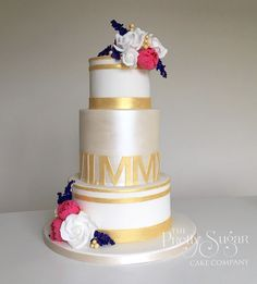 Roman numerals wedding cake with lustre and sugar flowers