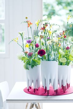 Colourful freesias look striking in a simple white vase.