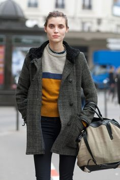 Love the entire ensemble, but would you look at the print on her shirt under the sweater. LOVE. Scott Schuman