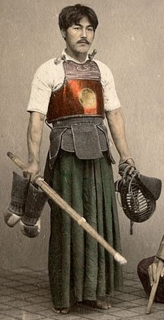 "Kendo Player, circa 1870's. Kendo (剣道 kendō?), meaning ""Way of The Sword"", is a modern Japanese martial art of sword-fighting descended from traditional swordsmanship (kenjutsu) which originated with the samurai class of feudal Japan. Swordsmen in Japan established schools of kenjutsu (the ancestor of kendo) which continued for centuries and which form the basis of kendo practice today."