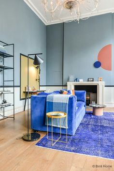 Denim Drift Wall color \ velvet sofa \ side table \ rug \ eclectic \ contemporary \ powder blue \ cerulean \ living room \