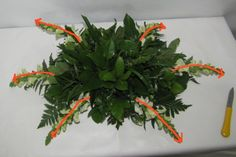 Learn how to make wedding centerpieces, bridal bouquets, corsages, boutonnieres and church decorations.  Buy wholesale flowers and discount florist supplies.