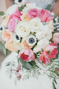White and pink wedding bouquet with anemones and roses.