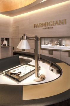 Notice how this is set up to feel elegant and inviting because of the use of warm colors.  Parmigiani Fleurier luxury watch boutique, London store design