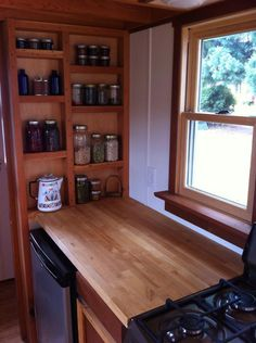 Beautiful and uncluttered tiny house kitchen