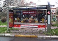 Awesome Outdoor Ads: A bus shelter that looks like the front counter of a McDonalds