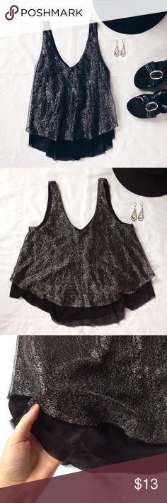 Express Black Metallic Shimmer Swing Crop Top Super cute and on trend black shimmer crop top. Cut like a swing crop top. Black sheer lining underneath with the silver metallic sheer material over the top. Great condition only worn a couple times. Express