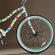 Peace out, boring bikes! Bike stickers and charms make these wheels adorable.   http://www.womenshealthmag.com/life/holiday-gift-guide-friends-with-fams?cm_mmc=Pinterest-_-womenshealth-_-content-life-_-giftsforfriendswithkids