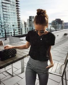 black tee + checked pants + bun + sunnies.