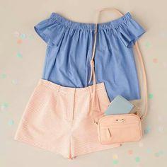 Blue shirt. Striped shorts.