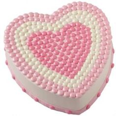 Your heartfelt sentiment for Mom will shine through when you present her with this lovely cake. Pipe dots with color flow and add dazzle with a sprinkle of Pearl Dust.